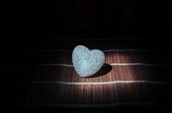 Valentine's Day composition with sweet burning multicolored heart on dark background, selective focus, or love greeting card of he Royalty Free Stock Image