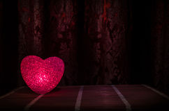 Valentine's Day composition with sweet burning multicolored heart on dark background, selective focus, or love greeting card of he Royalty Free Stock Photography