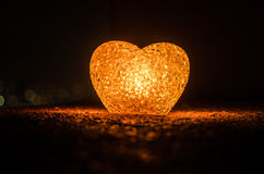 Valentine's Day composition with sweet burning multicolored heart on dark background, selective focus, or love greeting card of he Royalty Free Stock Images