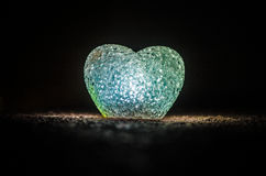 Valentine's Day composition with sweet burning multicolored heart on dark background, selective focus, or love greeting card of he Stock Photography