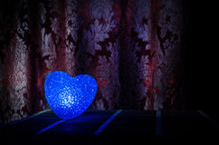 Valentine's Day composition with sweet burning multicolored heart on dark background, selective focus, or love greeting card of he Royalty Free Stock Photo