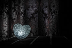 Valentine's Day composition with sweet burning multicolored heart on dark background, selective focus, or love greeting card of he Royalty Free Stock Photos