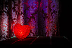 Valentine's Day composition with sweet burning multicolored heart on dark background, selective focus, or love greeting card of he Stock Photo