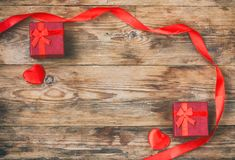 Valentine`s day composition, two red gift box, silk ribbon and h Royalty Free Stock Images