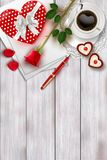 Valentine`s day composition on wooden table with heart shape objects and red rose Stock Images