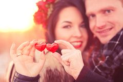 Valentine's Day concept. Lovers couple are holding pair of hearts in their hands as a symbol of love Stock Photo