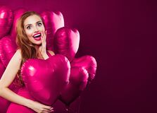 Free Valentine`s Day Concept Card Background. Happy Excited Woman Having Fun And Holding Heart Balloons Stock Photo - 171009980