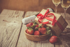 Valentine`s day concept - champagne, strawberry and present Stock Photos
