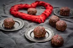Free Valentine`s Day Concept, Chocolate Profiteroles With Pink Hearts Stock Images - 109628054
