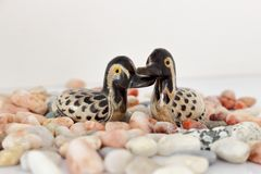 Valentine`s day concept. Couple in love, just married or honeymoon concept. Couple of stone mandarin ducks toy. royalty free stock photo