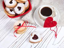 Valentine`s day concept / cup of coffee and biscuits shaped hear Stock Image