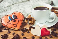 Valentine`s day concept . Cup of coffee and two heart on wooden background with food decor Royalty Free Stock Photo