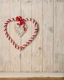 Valentine`s day concept. Decor heart vines on a light wooden bac Stock Photo