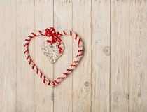 Valentine`s day concept. Decor heart vines on a light wooden bac Stock Photos