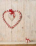 Valentine`s day concept. Decor heart vines on a light wooden bac Stock Image