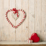 Valentine`s day concept. Decor heart vines and a small gift box Stock Photography