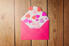 Valentine's day concept with envelope and heart shapes. Retro filter effect Stock Photography