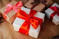 Valentine`s Day concept. Gift with red bow  on the wooden backgr. Ound, Valentines. Valentines gift boxes tied with a red satin ribbon bow on  background. gift Royalty Free Stock Photo