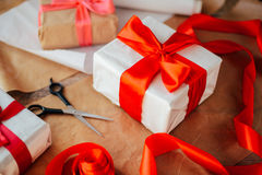 Valentine`s Day concept. Gift with red bow  on the wooden backgr. Ound, Valentines. Valentines gift boxes tied with a red satin ribbon bow on  background. gift Royalty Free Stock Photos