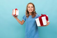 Valentine`s Day Concept. Girl With Two Boxes Of Gifts On A Light Blue Background Stock Images