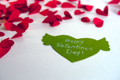 Valentine`s day concept. Green paper heart with wings and congratulation and red hearts on white background. Valentine`s day concept. Green paper heart with Royalty Free Stock Photos