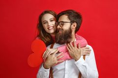 Valentine`s day concept. happy young couple with heart, flowers stock photography
