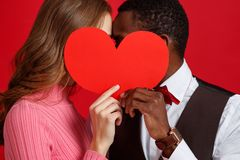 Valentine`s day concept. happy young couple with heart on red royalty free stock photos
