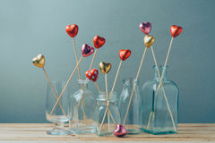 Valentine's day concept with heart shape chocolate in glass vases. Stock Image