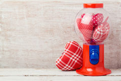 Valentine`s day concept with hearts inside gumball machine Stock Photo