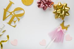 Valentine's day concept - ice cream cone and party decorations. Flat lay on white background stock images