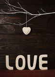 Valentine`s day concept. Letters LOVE and hearts made of yarn on stock photography