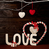 Valentine`s day concept. Letters LOVE and hearts made of yarn on royalty free stock photography
