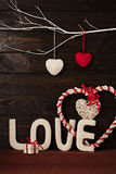 Valentine`s day concept. Letters LOVE and hearts made of yarn on stock photos