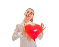 Valentine`s day concept. Love . Young happy girl with red heart isolated on white background in studio Royalty Free Stock Photo
