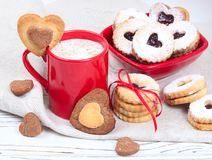 Valentine`s Day concept / red cup of coffee and biscuits shaped Stock Image