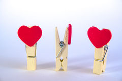 Valentine`s day concept. Red heart shape clothespins on white background.  Stock Photo