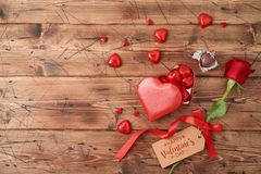 Valentine`s day concept with rose flower and heart shape chocolate stock image