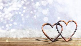 Valentine`s day. Rusty attached hearts on blur snow background, banner, copy space. 3d illustration. Valentine`s day concept. Rusty attached hearts on blur snow Royalty Free Illustration