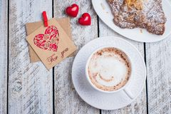Valentine`s day concept Top view, copy, flat lay. Valentine`s day concept with two hearts, gift card and cup of coffee, croissant. Top view stock photography