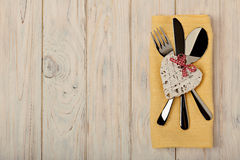 Valentine`s day concept. On the wooden table cutlery on linen na stock photography