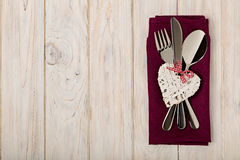 Valentine`s day concept. On the wooden table cutlery on linen na royalty free stock photo