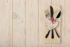 Valentine`s day concept. On the wooden table cutlery on linen na royalty free stock images