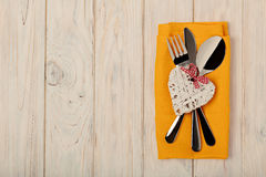 Valentine`s day concept. On the wooden table cutlery on linen na stock photos