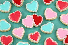 Valentine's Day Cookies. Heart cookies on a teal background royalty free stock photography