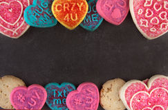 Valentine's day cookies on a black stone. Greeting card template Stock Image