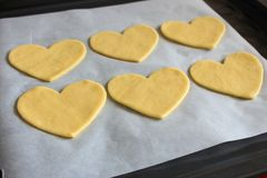 Valentine`s day cookies with heart shape. Baked hearts. Sweet love symbol. Cooking surprise. Romantic biscuit gift. Royalty Free Stock Photos
