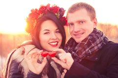 Valentine's Day couple. Young couple are holding pair of hearts as a symbol of their love Royalty Free Stock Photo