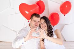Valentine`s day, a couple in love shows a heart out of their hands