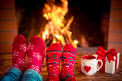 Valentine's day. Couple near fireplace. Valentine's day at home. Winter holiday concept Stock Images