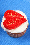 Valentine's day cupcake over a blue background Royalty Free Stock Photos